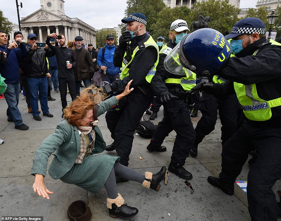 33653036-8775451-A_woman_falls_to_the_ground_near_policemen_as_officers_moved_in_-a-13_1601134123077